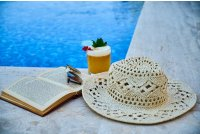 A Beige Straw Hat Book Sunglasses And Drink Beside A Pool Photo By Engin Akyurt From Pexels